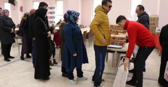 LÖSEV'den 30 Aileye  Giysi Yardımı